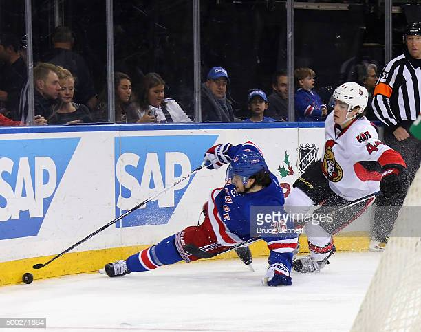 Mats Zuccarello of the New York Rangers is tripped up by JeanGabriel Pageau of the Ottawa Senators at Madison Square Garden on December 6 2015 in New...