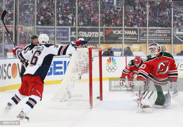 Mats Zuccarello of the New York Rangers scores a second period goal against Martin Brodeur of the New Jersey Devils with teammates during the 2014...