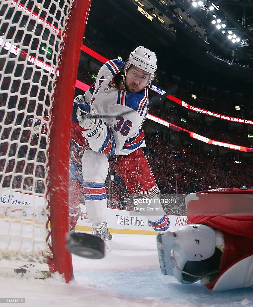 <a gi-track='captionPersonalityLinkClicked' href=/galleries/search?phrase=Mats+Zuccarello&family=editorial&specificpeople=7219903 ng-click='$event.stopPropagation()'>Mats Zuccarello</a> #36 of the New York Rangers scores at 6:27 of the first period against the Montreal Canadiens in Game One of the Eastern Conference Final during the 2014 Stanley Cup Playoffs at the Bell Centre on May 17, 2014 in Montreal, Canada. The Rangers defeated the Canadiens 7-2.