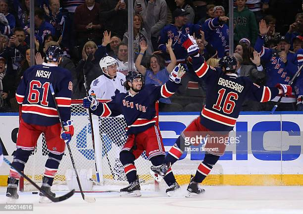 Mats Zuccarello of the New York Rangers scores his third goal of the game at 1911 of the third period against the Toronto Maple Leafs and is joined...