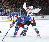 Mats Zuccarello of the New York Rangers skates against Zach Redmond of the Colorado Avalanche at Madison Square Garden on November 13 2014 in New...