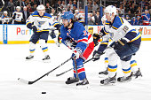 Mats Zuccarello of the New York Rangers skates with the puck against Jay Bouwmeester of the St Louis Blues at Madison Square Garden on November 12...
