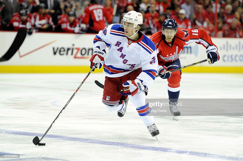 <a gi-track='captionPersonalityLinkClicked' href=/galleries/search?phrase=Mats+Zuccarello&family=editorial&specificpeople=7219903 ng-click='$event.stopPropagation()'>Mats Zuccarello</a> #36 the New York Rangers brings the puck down the ice in the second period against <a gi-track='captionPersonalityLinkClicked' href=/galleries/search?phrase=Eric+Fehr&family=editorial&specificpeople=566939 ng-click='$event.stopPropagation()'>Eric Fehr</a> #16 of the Washington Capitals in Game One of the Eastern Conference Quarterfinals during the 2013 NHL Stanley Cup Playoffs at Verizon Center on May 2, 2013 in Washington, DC.