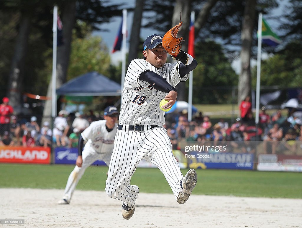 Matsuda Hikaru of Japan pitches during the pool B match between New Zealand Black Sox and Japan at Rosedale Park, Albany on March 3, 2013 in Auckland, New Zealand.