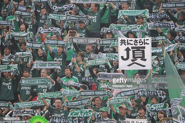 Matsumoto Yamaga FC supporters hold mufflers prior to the JLeague second division match between Yokohama FC and Matsumoto Yamaga FC at Nippatsu...