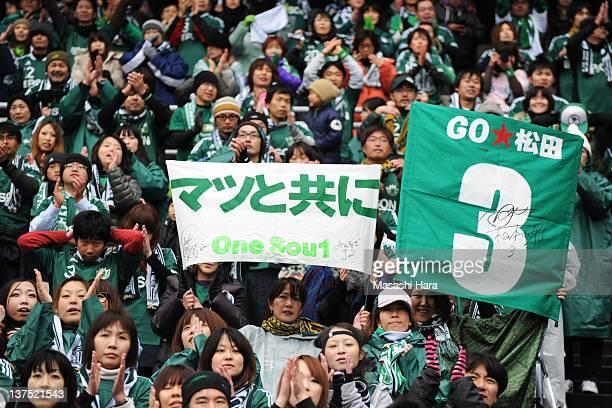 Matsumoto Yamaga FC's supporters hold banners proclaiming Naoki Matsuda during Naoki Matsuda Memorial Game at Nissan Stadium on January 22 2012 in...