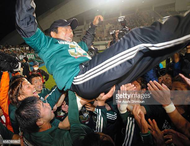 Matsumoto Yamaga head coach Yasuharu Sorimachi is thrown into the air to celebrate his team's promotion to the top league after the JLeague second...