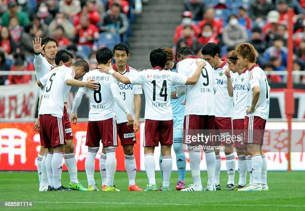 Matsumoto Yamaga players form a huddle during the JLeague match between Urawa Red Diamonds and Matsumoto Yamaga at Saitama Stadium on April 4 2015 in...