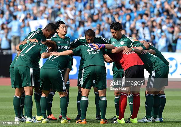 Matsumoto Yamaga players form a huddle prior to the JLeague match between Kawasaki Frontale and Matsumoto Yamaga at Todoroki Stadium on June 20 2015...