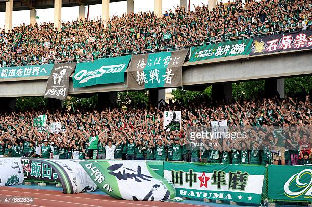 Matsumoto Yamaga supporters cheer prior to the JLeague match between Kawasaki Frontale and Matsumoto Yamaga at Todoroki Stadium on June 20 2015 in...