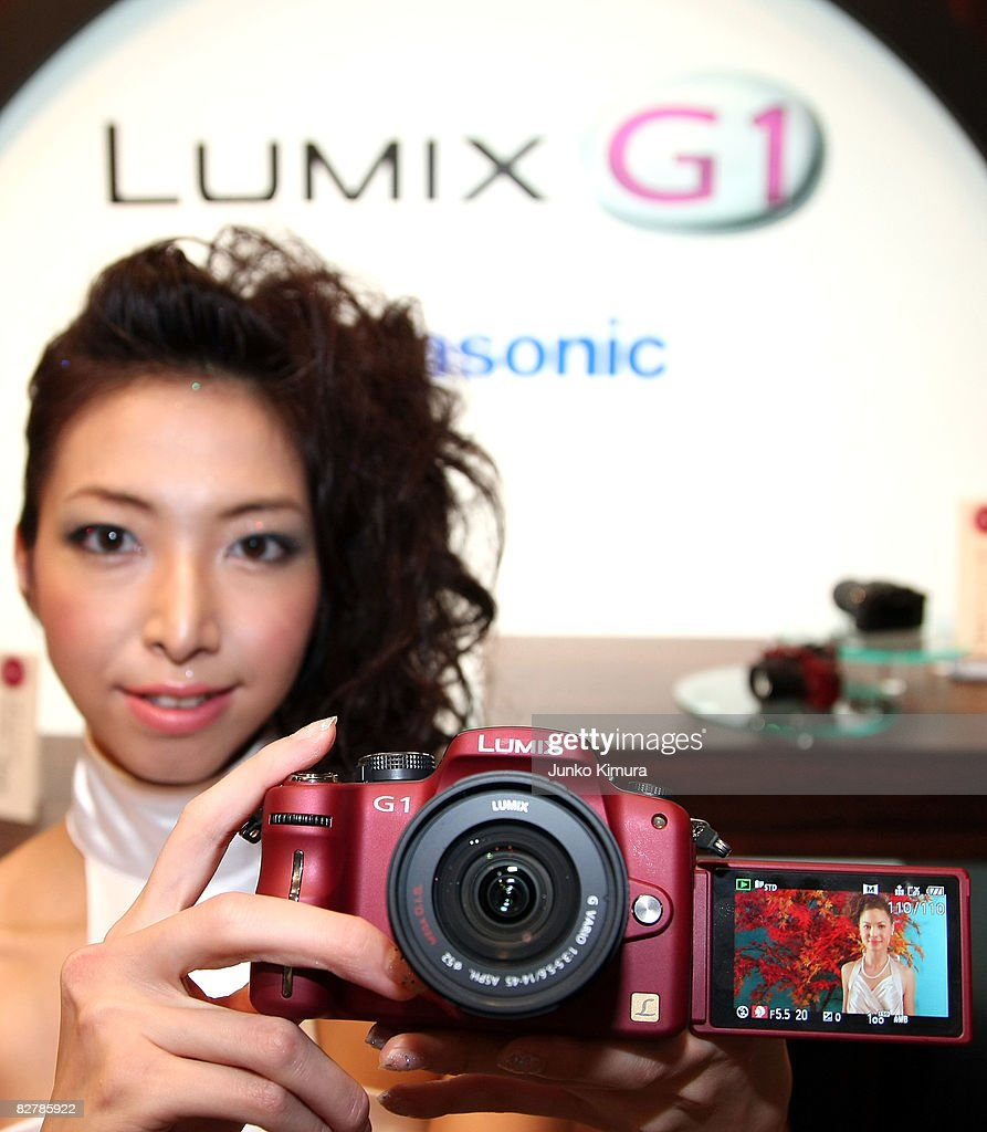 Matsushita Electric Industrial Co., Ltd's world's smallest new single-lens reflex camera Lumix G1 is on display during a press conference at Izumi Garden Gallery on September 12, 2008 in Tokyo, Japan. The mirror-less structure of the body and the interchangeable lens, the camera is the smallest and lightest in the cameras equipped interchangeable lens and free-angle LCD screen. The weight of the body is less than 400 grams.