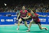 Matsutomo Misaki and Takahashi Ayaka of Japan return to Wang Xiaoli and Yu Yang of China during their women's doubles semi final match at the...