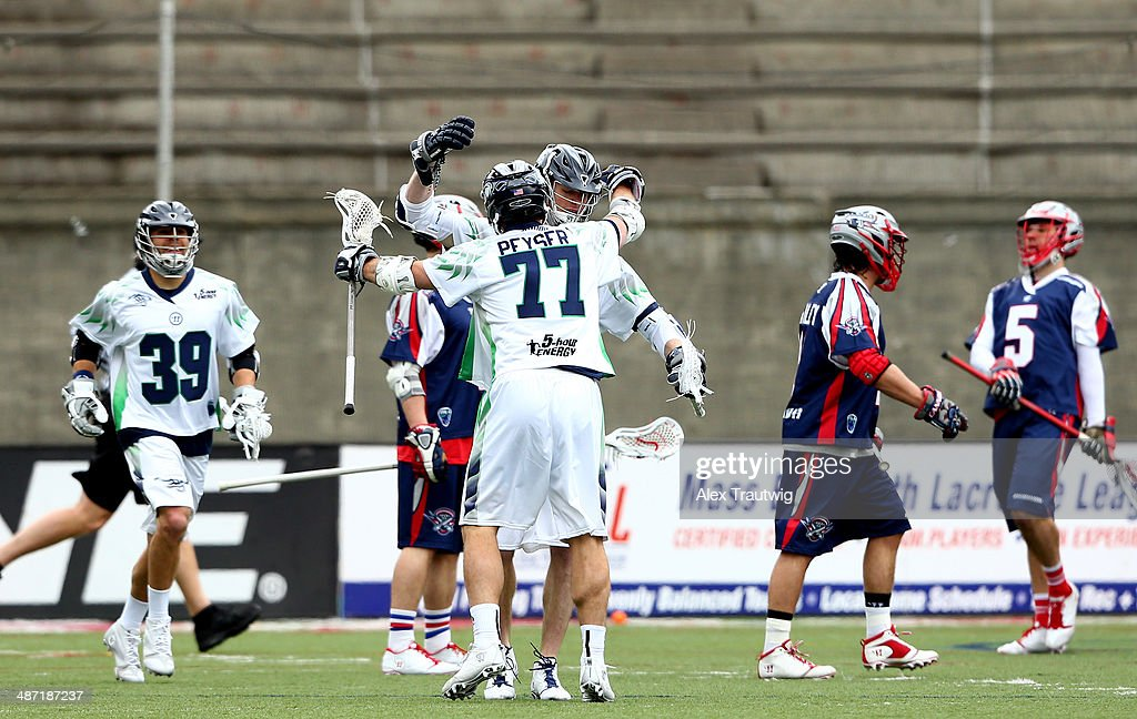 Matt Abbott and Stephen Peyser of the Chesapeake Bayhawks celebrate a goal against the Boston Cannons during a game at Harvard Stadium on April 27...