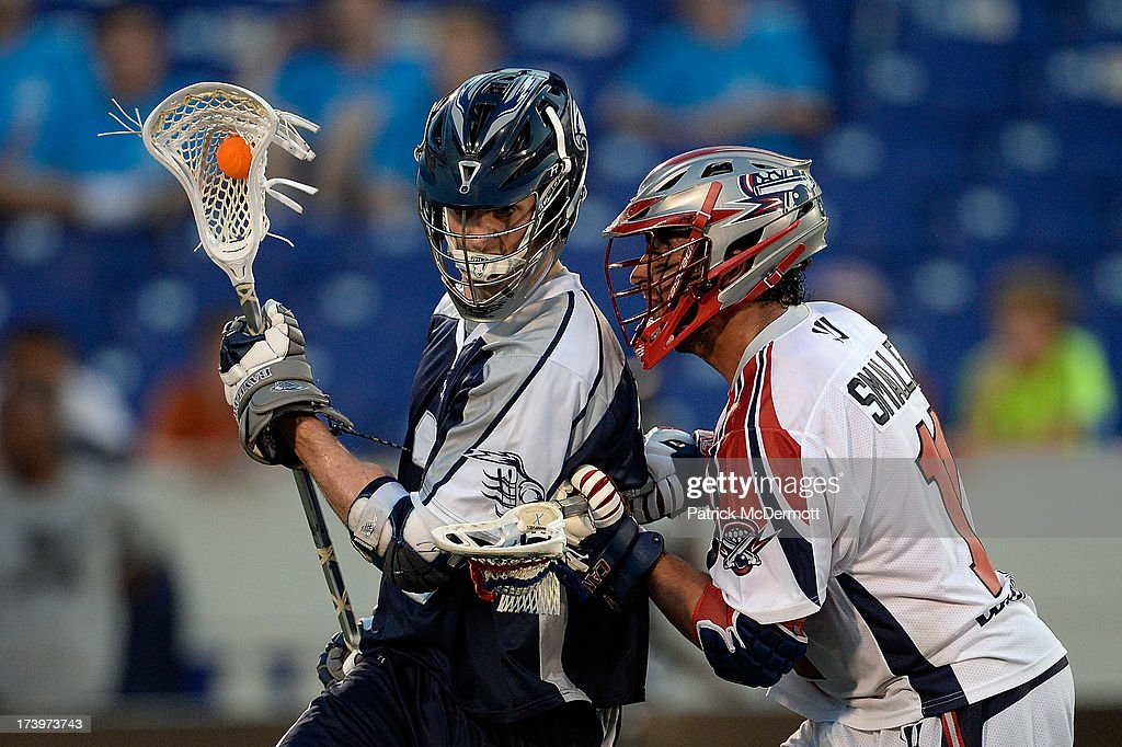Matt Abbott #3 of Chesapeake Bayhawks battles for the ball against Matt Smalley #11 of Boston Cannons during a game at Navy-Marine Corps Memorial Stadium on July 18, 2013 in Annapolis, Maryland.