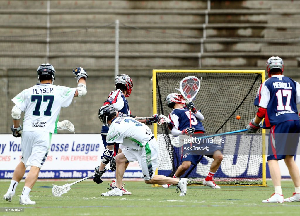 Matt Abbott of the Chesapeake Bayhawks scores a goal on Jordan Burke of the Boston Cannons during a game at Harvard Stadium on April 27 2014 in...