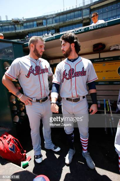 Matt Adams and Dansby Swanson of the Atlanta Braves talk in the dugout prior to the game against the Oakland Athletics at the Oakland Alameda...