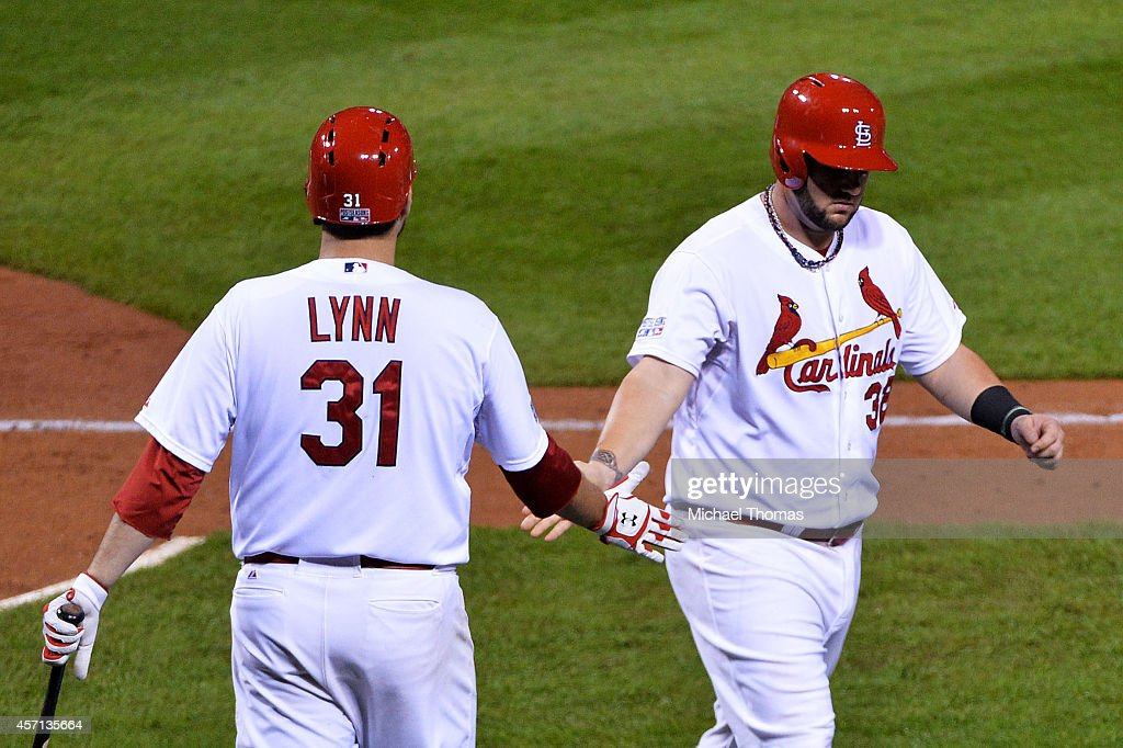 Matt Adams celebrates with Lance Lynn of the St Louis Cardinals after he scored on a single by Randal Grichuk in the fourth inning against the San...