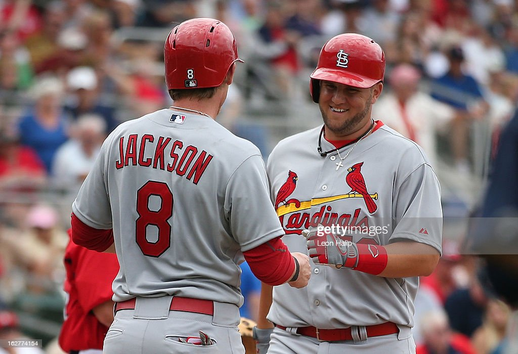 Matt Adams #53 of the St. Louis Cardinals celebrates a two run home run to center field in the seventh inning with teammate Ryan Jackson #8 during the the game against the Boston Red Sox at JetBlue Park on February 26, 2013 in Fort Myers, Florida.
