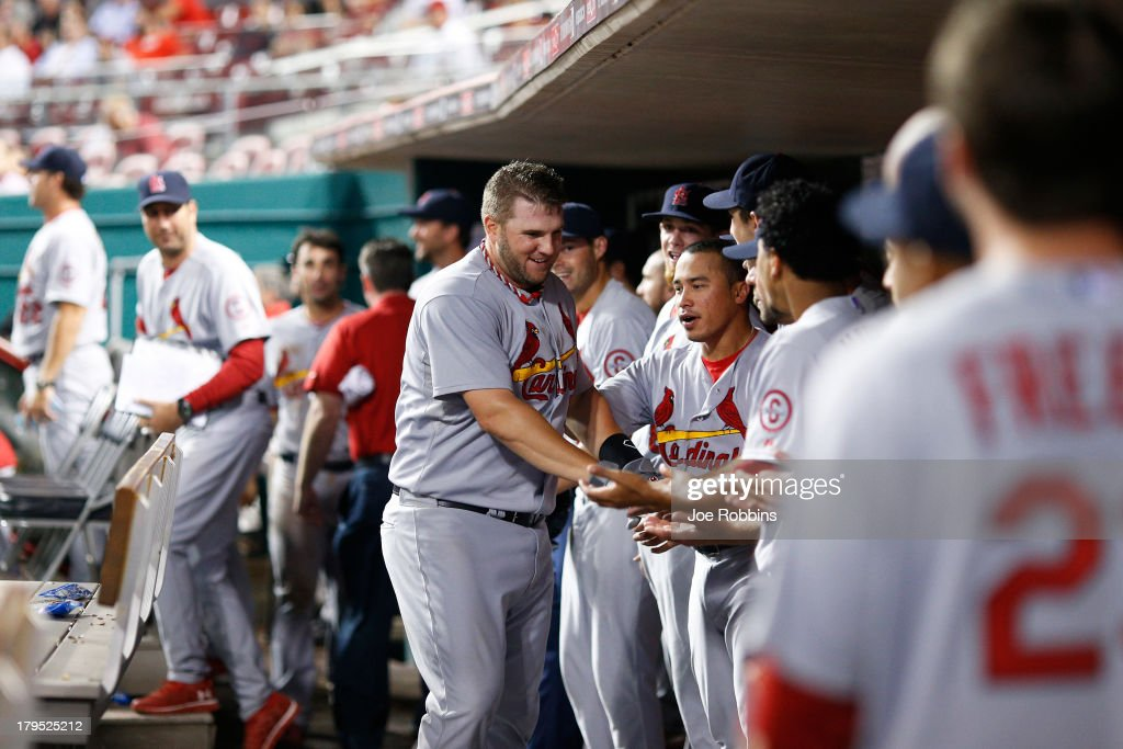 Matt Adams #53 of the St. Louis Cardinals celebrates in the dugout after hitting a home run in the 16th inning of the game against the Cincinnati Reds at Great American Ball Park on September 4, 2013 in Cincinnati, Ohio. The Cardinals won 5-4 in 16 innings.