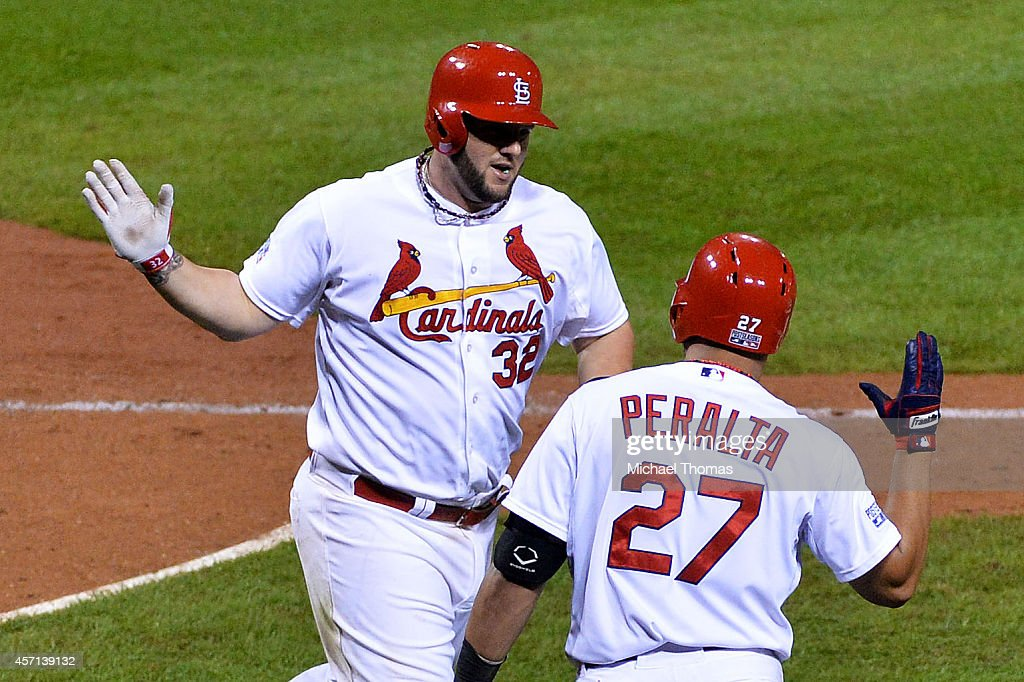 Matt Adams #32 of the St. Louis Cardinals celebrates with <a gi-track='captionPersonalityLinkClicked' href=/galleries/search?phrase=Jhonny+Peralta&family=editorial&specificpeople=213286 ng-click='$event.stopPropagation()'>Jhonny Peralta</a> #27 after hitting a solo home run in the eighth inning against the San Francisco Giants during Game Two of the National League Championship Series at Busch Stadium on October 12, 2014 in St Louis, Missouri.