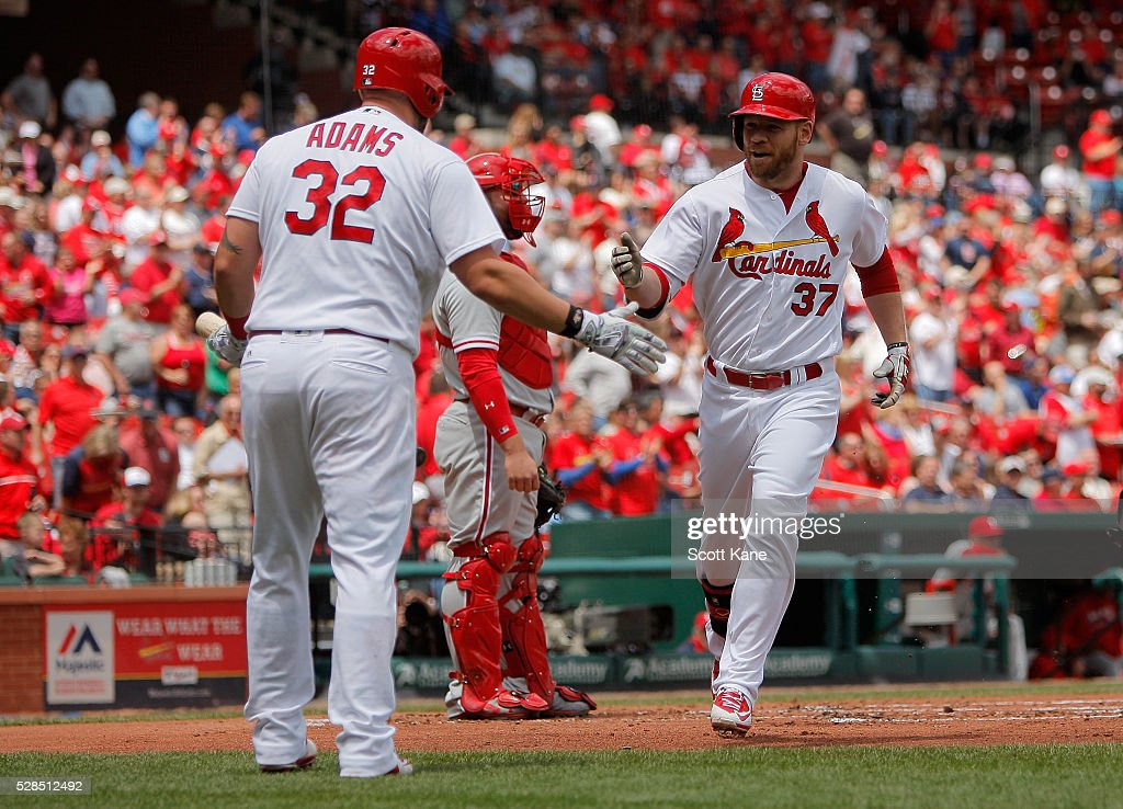 Matt Adams #32 of the St. Louis Cardinals congratulates Brandon Moss #37 after Moss hit a solo home run during the first inning against the Philadelphia Phillies at Busch Stadium on May 5, 2016 in St. Louis, Missouri.