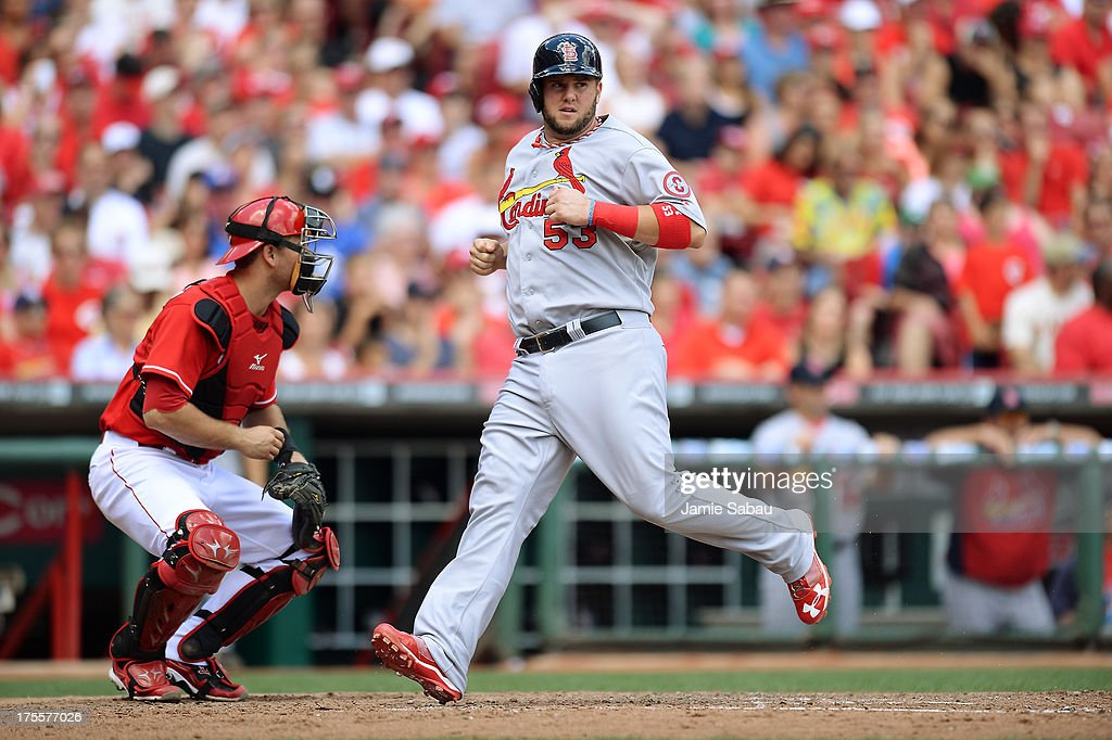 Matt Adams #53 of the St. Louis Cardinals crosses home plate in the sixth inning for another one of St. Louis' 15 runs against the Cincinnati Reds at Great American Ball Park on August 4, 2013 in Cincinnati, Ohio. St. Louis defeated Cincinnati 15-2.