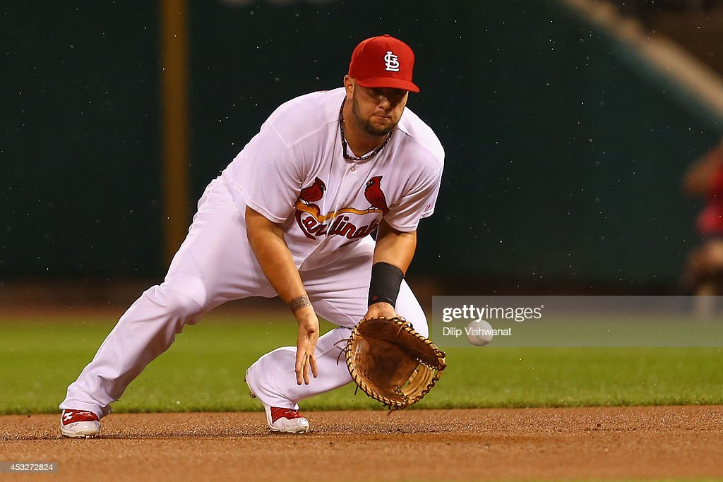 Matt Adams #32 of the St. Louis Cardinals fields a ground ball for an out against the Boston Red Sox in the first inning at Busch Stadium on August 6, 2014 in St. Louis, Missouri.