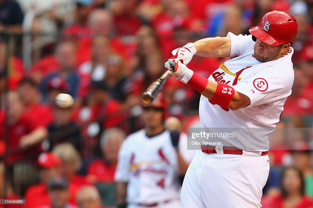 Matt Adams #53 of the St. Louis Cardinals hits an RBI single against the Philadelphia Phillies in the third inning at Busch Stadium on July 25, 2013 in St. Louis, Missouri.