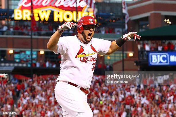 Matt Adams of the St Louis Cardinals reacts after hitting a three run home run in the seventh inning against the Los Angeles Dodgers in Game Four of...