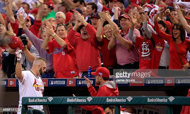 Matt Adams of the St Louis Cardinals reacts as the crowd cheers after hitting a three run home run in the seventh inning against the Los Angeles...