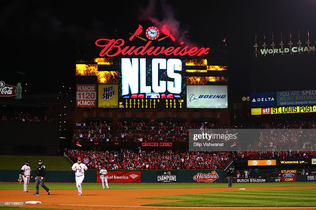 Matt Adams #32 of the St. Louis Cardinals runs the bases after hitting a solo home run in the eighth inning against the San Francisco Giants during Game Two of the National League Championship Series at Busch Stadium on October 12, 2014 in St Louis, Missouri.
