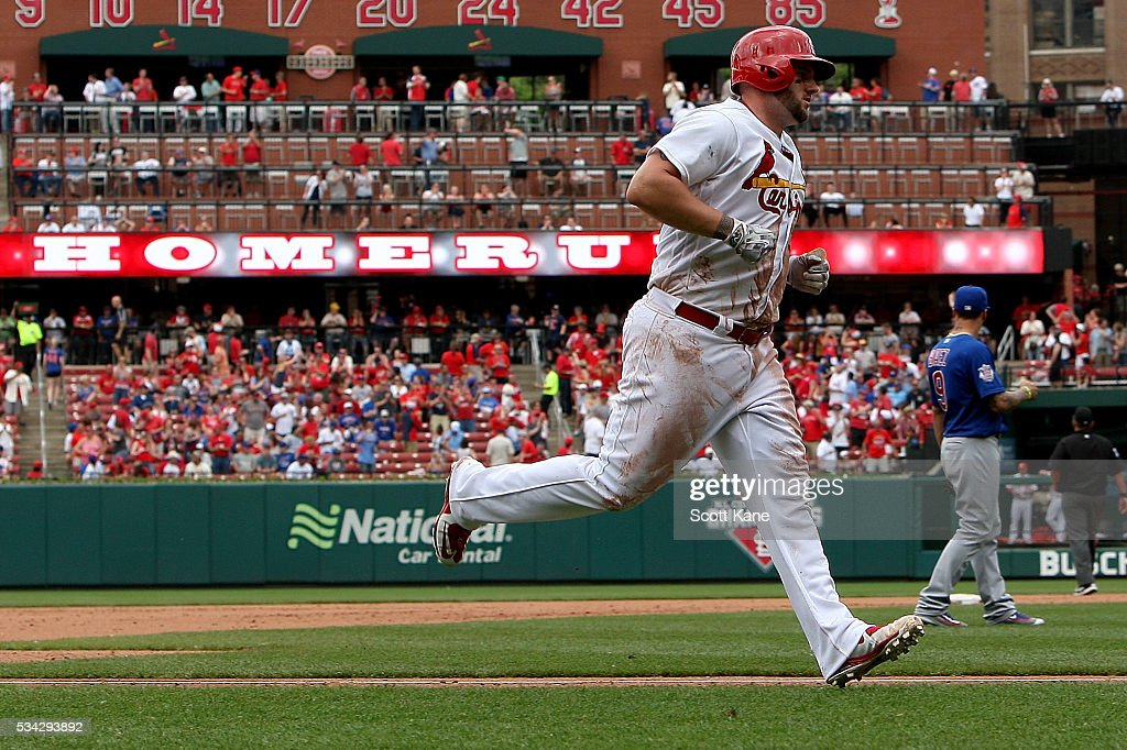 <a gi-track='captionPersonalityLinkClicked' href=/galleries/search?phrase=Matt+Adams+-+Baseball+Player&family=editorial&specificpeople=12797358 ng-click='$event.stopPropagation()'>Matt Adams</a> #32 of the St. Louis Cardinals runs the bases after hitting a solo home run during the seventh inning of a baseball game against the Chicago Cubs at Busch Stadium on May 25, 2016 in St. Louis, Missouri.