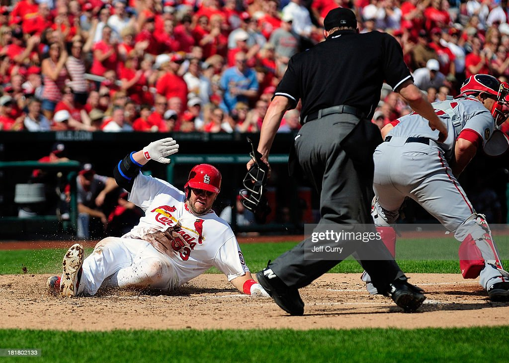 Matt Adams #53 of the St. Louis Cardinals slides safely past <a gi-track='captionPersonalityLinkClicked' href=/galleries/search?phrase=Wilson+Ramos&family=editorial&specificpeople=4866956 ng-click='$event.stopPropagation()'>Wilson Ramos</a> #40 of the Washington Nationals during the fourth inning at Busch Stadium on September 25, 2013 in St. Louis, Missouri.