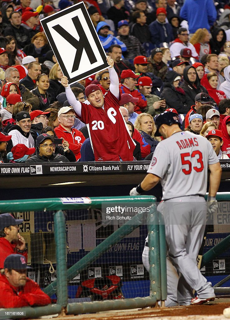 Matt Adams #53 of the St. Louis Cardinals walks into the dugout as a fan holds a K sign after he struck out with the basses loaded in the seventh inning against the Philadelphia Phillies in a MLB baseball game on April 21, 2013 at Citizens Bank Park in Philadelphia, Pennsylvania. The Phillies defeated the Cardinals 7-3.