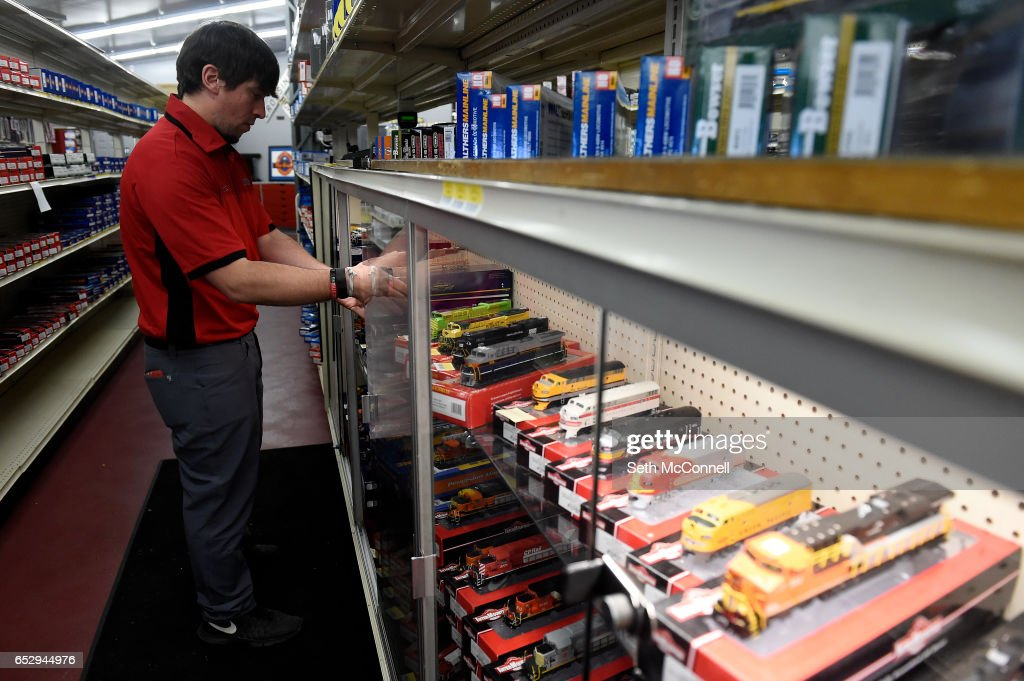 Matt Adamski pulls HO-scale locomotives from their boxes to be put on display at Caboose Hobbies on March 8, 2017 in Lakewood, Colorado. Caboose Hobbies, the 'world's largest model train shop,' has re-opened in Lakewood.
