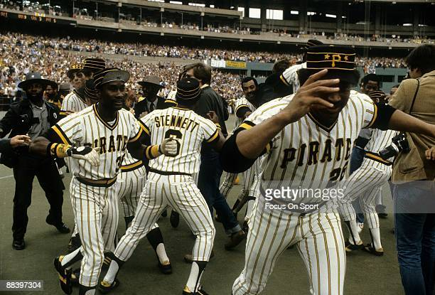 Matt Alexander Rennie Stennett and Jim Bibby of the Pittsburgh Pirates run on to the field with jubilation after the Pirates defeated the Cincinnati...