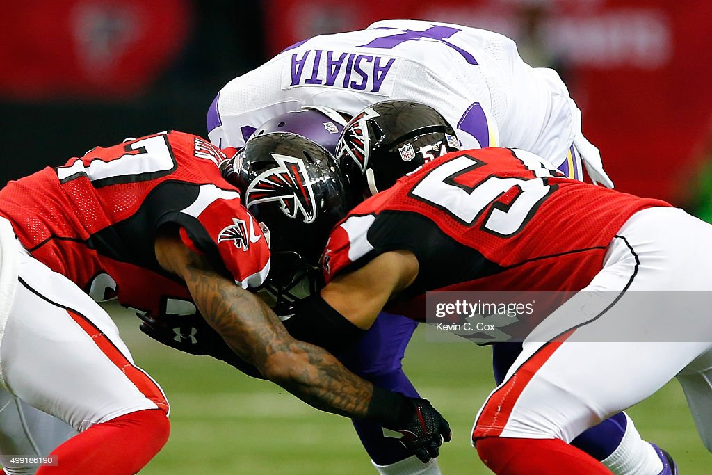 <a gi-track='captionPersonalityLinkClicked' href=/galleries/search?phrase=Matt+Asiata&family=editorial&specificpeople=5509647 ng-click='$event.stopPropagation()'>Matt Asiata</a> #44 of the Minnesota Vikings is tackled by <a gi-track='captionPersonalityLinkClicked' href=/galleries/search?phrase=Nathan+Stupar&family=editorial&specificpeople=6234772 ng-click='$event.stopPropagation()'>Nathan Stupar</a> #54 and <a gi-track='captionPersonalityLinkClicked' href=/galleries/search?phrase=Ricardo+Allen&family=editorial&specificpeople=7172781 ng-click='$event.stopPropagation()'>Ricardo Allen</a> #37 of the Atlanta Falcons during the first half at the Georgia Dome on November 29, 2015 in Atlanta, Georgia.