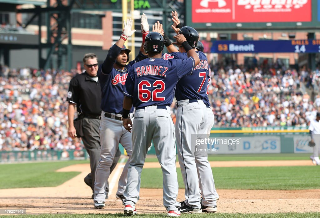 Matt Aviles #4 of the Cleveland Indians celebrates after hitting a ninth inning grand slam scoring Jose Ramirez #62 Michael Brantley #23 and Matt Carson #7 during the game against the Detroit Tigers at Comerica Park on September 1, 2013 in Detroit, Michigan.
