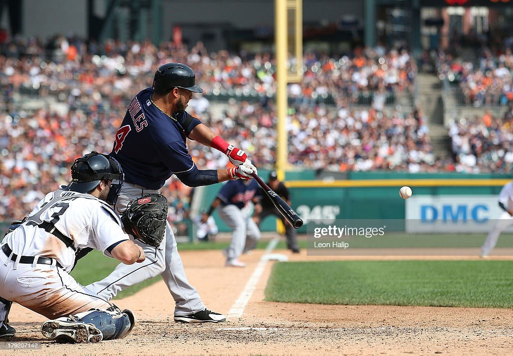 Matt Aviles #4 of the Cleveland Indians hits a ninth inning grand slam scoring Jose Ramirez #62 Michael Brantley #23 and Matt Carson #7 during the game against the Detroit Tigers at Comerica Park on September 1, 2013 in Detroit, Michigan.