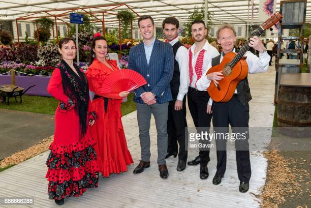 Matt Baker poses with traditional Spanish flamenco dancers accompanied by Spanish guitar perform at the RHS Chelsea Flower Show on May 22 2017 in...
