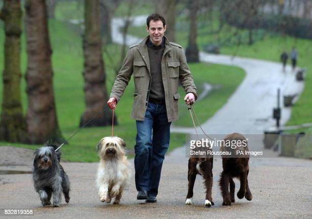 Matt Baker presenter of this year's Crufts Dog Show walks some of the entrants in London's Green Park today during a photocall to announce the show...