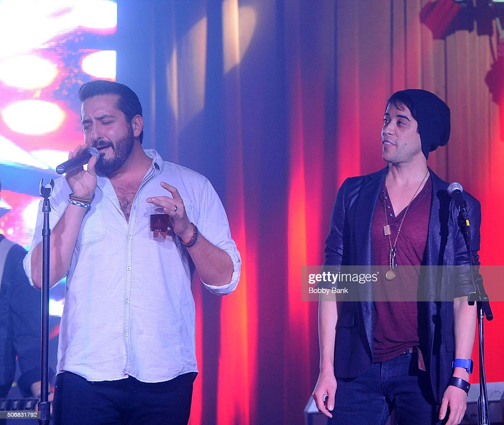 Matt Ban and Mitch Jarvis performs at the 'Rock Of Ages' Broadway Cast Reunion Concert at Highline Ballroom on January 25 2016 in New York City