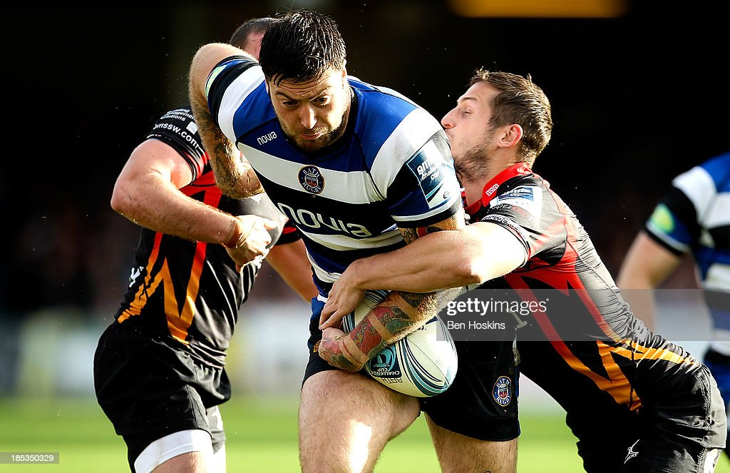 Matt Banahan of Bath attempts to break through the Newport defence during the Amlin Challenge Cup match between Bath and Newport Gwent Dragons at Recreation Ground on October 19, 2013 in Bath, England.