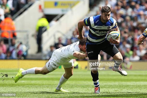 Matt Banahan of Bath evades the tackle from Duncan Taylor of Saracens during the Aviva Premiership Final between Bath Rugby and Saracens at...