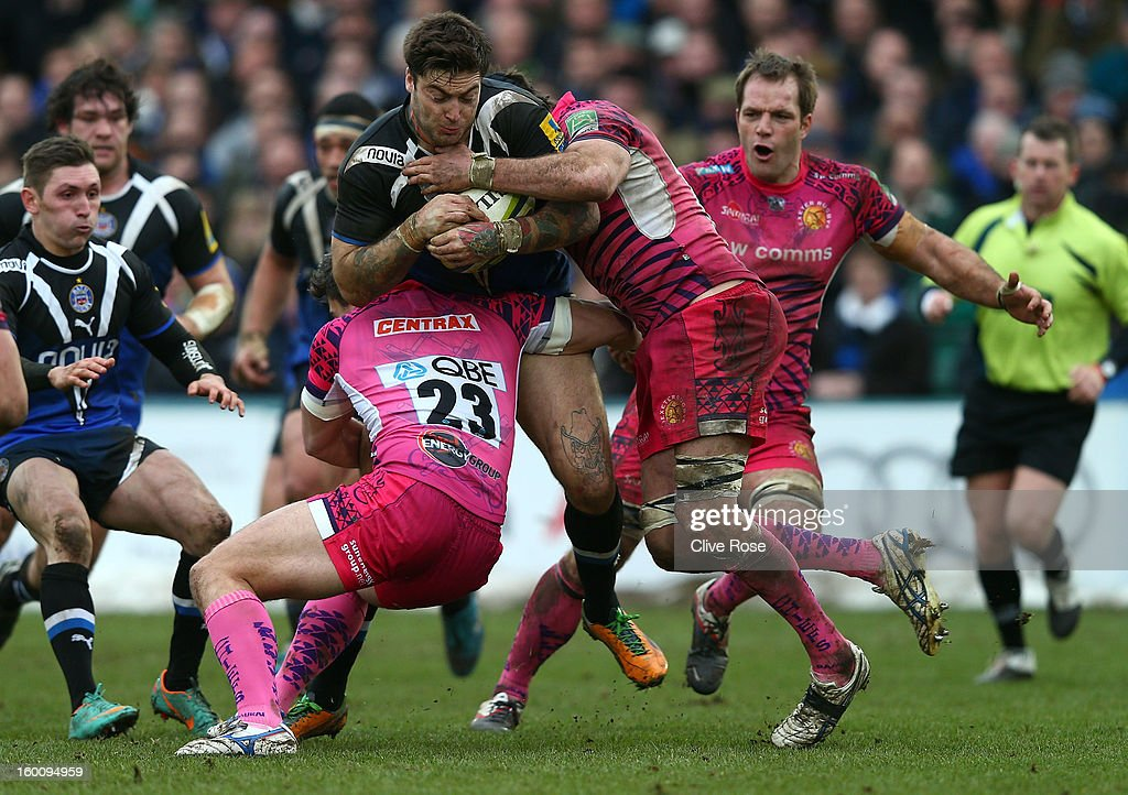 <a gi-track='captionPersonalityLinkClicked' href=/galleries/search?phrase=Matt+Banahan&family=editorial&specificpeople=2156682 ng-click='$event.stopPropagation()'>Matt Banahan</a> of Bath is challenged by Mark Foster of Exeter Chiefs during the LV= Cup match between Bath and Exeter Chiefs at the Recreation Ground on January 26, 2013 in Bath, England.