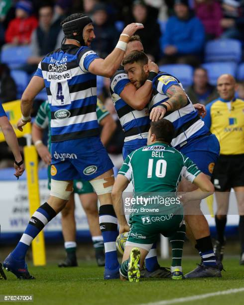 Matt Banahan of Bath Rugby celebrates with team mates after scoring their first try during the Aviva Premiership match between London Irish and Bath...