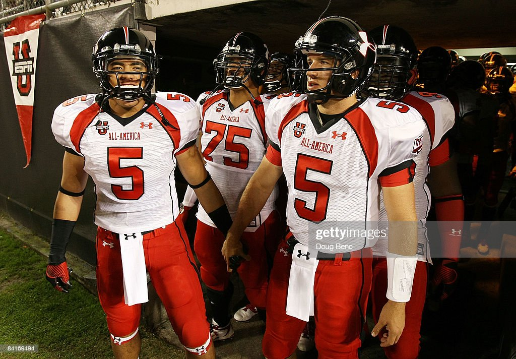 Matt Barkley and linebacker Manti Teo of the white team lead their team onto the field before the All America Under Armour Footbal Game at Florida...