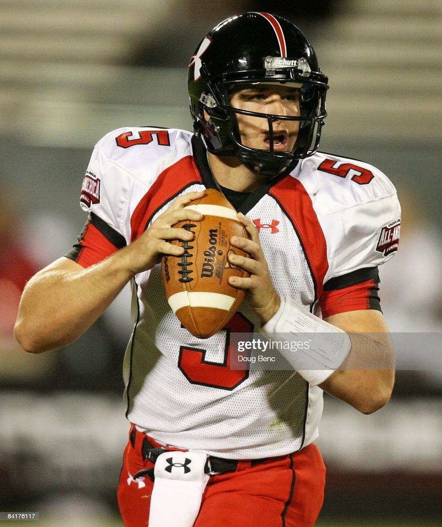 Matt Barkley of the white team drops back to pass during the All America Under Armour Football Game at Florida Citrus Bowl on January 4 2009 in...