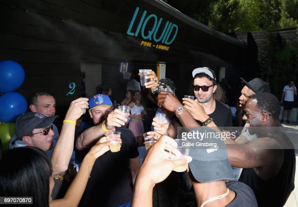 Matt Barnes Zaza Pachulia and Draymond Green of the Golden State Warriors attend a NBA championship celebration at the Liquid Pool Lounge at the Aria...