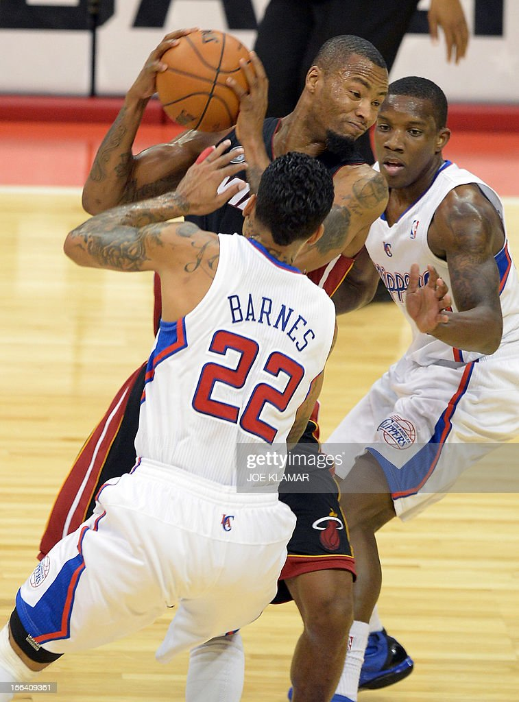 Matt Barnes and Eric Bledsoe (R) of Clippers and Rashard Lewis (TOP) of Heat fight for a ball during the NBA game between Los Angeles Clippers and Miami Heat in Staple Center on November 14, 2012 in Los Angeles, California.